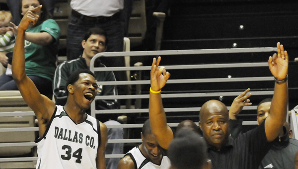 Dallas County's William Lee and head coach Willie Moore celebrate the Hornets' victory.--Daniel Evans