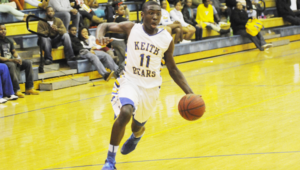 Keith's John Pettway races the ball up the floor in the Bears' blowout win over Ellwood Christian Friday night. With the win, Keith moves on to the Class 1A, Area 5 championship game and will face Autaugaville. With the loss, Ellwood Christian's season comes to an end.--Daniel Evans