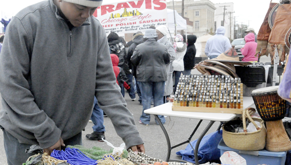 A customer looks through beads at one of the vendors during the 2013 Bridge Crossing Jubilee.  Dozens of vendors line Water Avenue during the two-day festival.