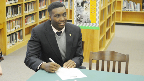 Dallas County's Justin Chandler signed his letter of intent to play for Faulkner University Wednesday morning.
