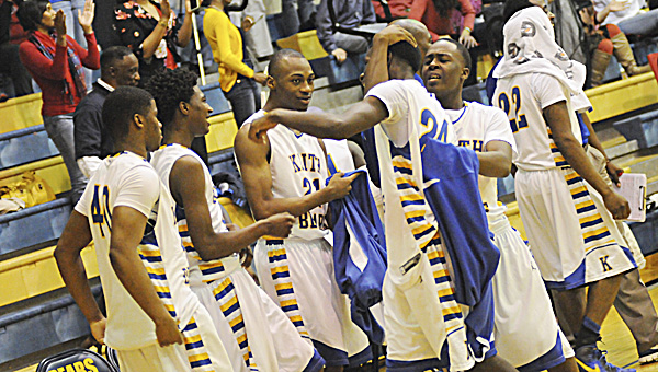 Keith players celebrate after a 79-44 win over Holy Spirit Friday.--Josh Bergeron