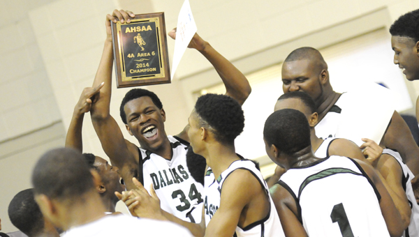 Dallas County's William Lee holds up the Class 4A, Area 6 championship plaque the Hornets were awarded after their win over Tallassee Monday night. The Hornets blew out the Tigers 73-30 and will take on Beauregard High School Friday in a sub-regional game.--Josh Bergeron