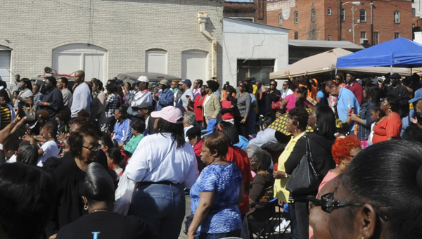 A huge crowd gathers at the end of Water Avenue in front of ArtsRevive Carneal Building to watch the gospel musical quartet Mighty Clouds of Joy perform at the Jubilee Festival event tied to the annual Bridge Crossing Jubilee. (Sarah Robinson   Times-Journal)