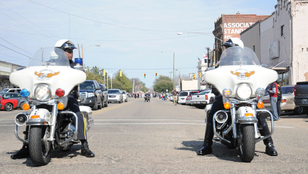 A Selma Police officer leads the Bridge Crossing Jubilee Parade on Sunday. (Josh Bergeron | Times-Journal)