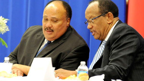 Martin Luther King III, left, exchanges words with Selma Mayor George Evans before Martin's speech at the  King Unity Breakfast held Sunday at Wallace Community College-Selma. (Sarah Robinson | Times-Journal)