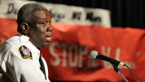 Lt. Johnny King speaks to the youth Thursday at J.A. Pickard Auditorium  during the School of Discovery Genesis Center's Student Union: Stop the Violence ceremony. (Sarah Robinson   Times-Journal)