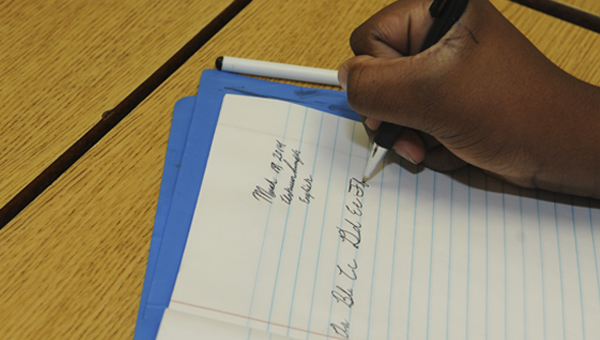 Antwun Rumph, a fifth grade student at Edgewood Elementary, writes the alphabet in cursive Thursday in Shayla Williams' fifth grade class.   --Sarah Robinson