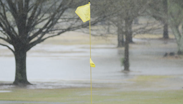 The Selma Country Club was drenched by pouring rain Friday morning, resulting in water soaking the fairways, greens and bunkers. By the afternoon, crews had started preparing the course for Saturday, starting with clearing the water drains and bunkers.--Daniel Evans