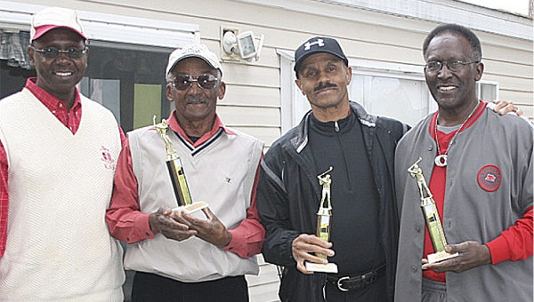Kappa Alpha Psi Fraterntiy golf tournament coordinator Leroy Maxwell, left, stands with the winning men's team of  John Lovett, Harold Lovett and Albert Southall.--Submitted Photo