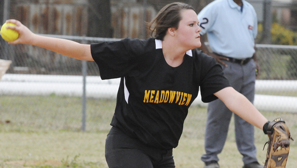 Meadowview Christian pitcher Claudia Kendrick delivers a pitch in the Trojans 8-3 win over Sumter Academy Thursday afternoon. Kendrick pitched all seven innings for Meadowview.--Daniel Evans