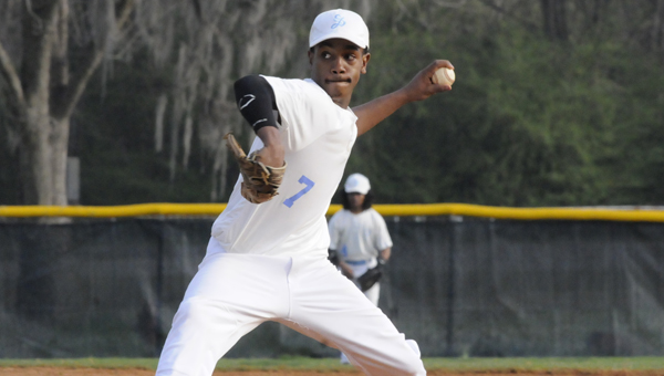 Selma pitcher Keyshawn Ford, above, throws off the pitcher's mound in Friday's game against Demopolis. --Daniel Evans