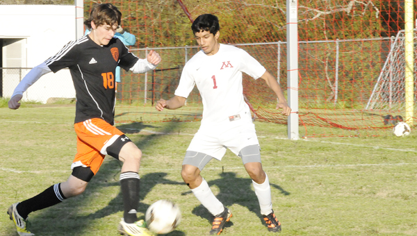 Morgan Academy's Diyan Patel, above, attempts to steal possession of the ball from a Hooper Academy player in Tuesday night's game.  Morgan Academy's Harrison Watters, below, races the ball down the field. The Senators won the game 2-0 to advance to the playoffs for the first time.--Daniel Evans