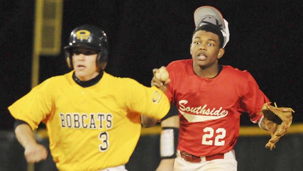 Southside Panthers' second baseman Khamari Gibbs tries to catch Opp's Austin Hollinghead as his hat flies off in a rundown in the second game of a double header Saturday night at Bloch Park. Opp won the second game 24-5.--Daniel Evans