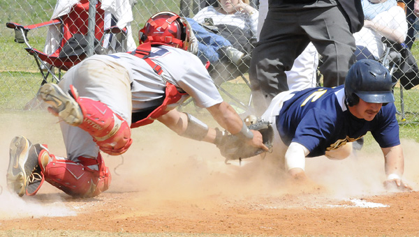 Wallace Community College Selma catcher, left, Josh Gonzalez attempts to tag Central Alabama Community College's Kyler Deese at home plate during Thursday's game. Deese overran home but dove back in time to touch the plate before getting tagged by Gonzalez in the Trojans 12-2 victory.--Daniel Evans