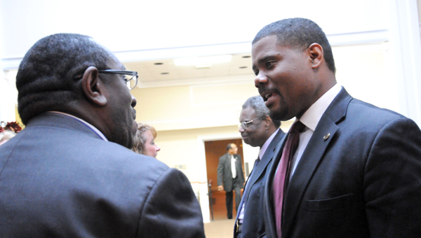Welcoming party: State Rep. Darrio Melton, D-Selma, (right) talks to Perry County Commissioner Albert Turner during the opening ceremony of the Bridge Crossing Jubilee. (Josh Bergeron | Times-Journal)