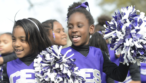 Jay Sowers | Times-Journal Cheer for change: Clark Elementary Schools first grade students Rachel Curtis, left, and Allanah Davis prepare to perform with their fellow cheerleaders during the Smoke Out the Violence Rally Tuesday.
