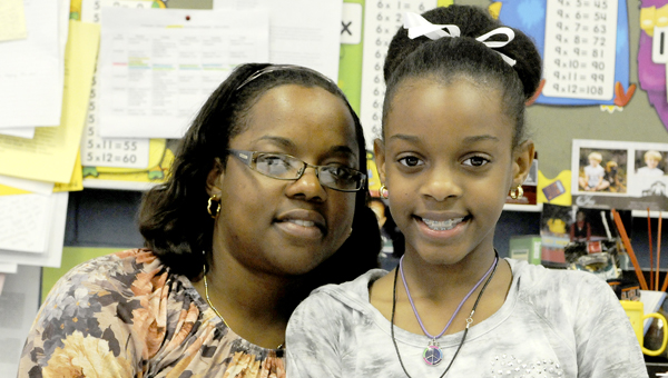 Josh Bergeron | Times-Journal Champion chef: Valley Grande Student Kindall Sewell-Murphy smiles with her mother, Toby Sewell-Murphy on Wednesday. Kindall won the 2013 Healthy Lunchtime Challenge for Alabama.