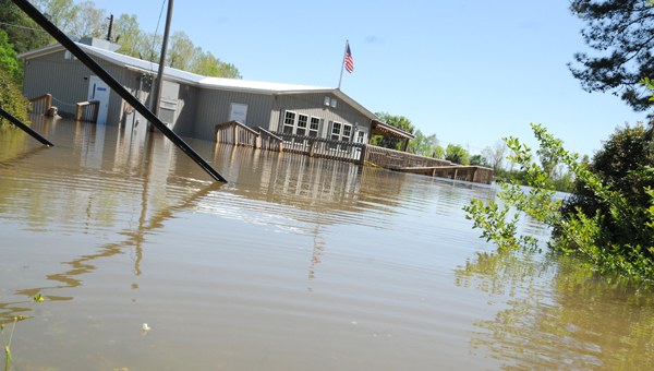 Coming to a crest: Above, water tops the deck of the Sand Bar restaurant near the Selma Marina Wednesday.