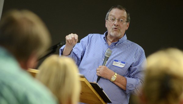 Retired pastor Doug Abner tells the story of community-wide revival in Manchester, KY during a program at Blue Jean Selma late Friday evening. (Jay Sowers | Times-Journal)