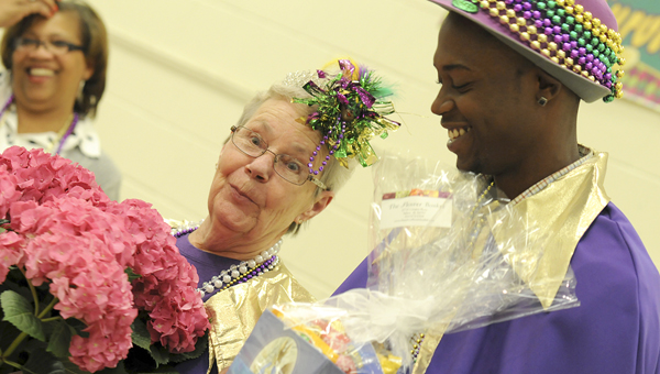 Selma residents Sharon McGuire, middle, and Tracey Palmer Jr., right, were announced the king and queen of the Relay for Life Sherri S. James Survivor's Banquet Tuesday night. Held annually, the banquet is a one of the kickoff events leading up to Friday's Relay for Life event, which raises money for the American Cancer Society. (Sarah Robinson   Times-Journal)