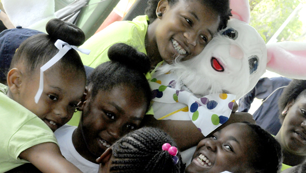Children greet the Easter bunny Saturday with hugs at Bloch park during Selma's first annual Easter Egg Hunt. (Sarah Robinson   Times-Journal)