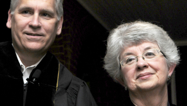 First Baptist Church Pastor Dr. Jerry Light, Sr., right, and Church Street United Methodist Church Pastor Reba Wiley pose for the camera outside of First Presbyterian Church Thursday after leading the Maundy Thursday service. (Sarah Robinson | Times-Journal)