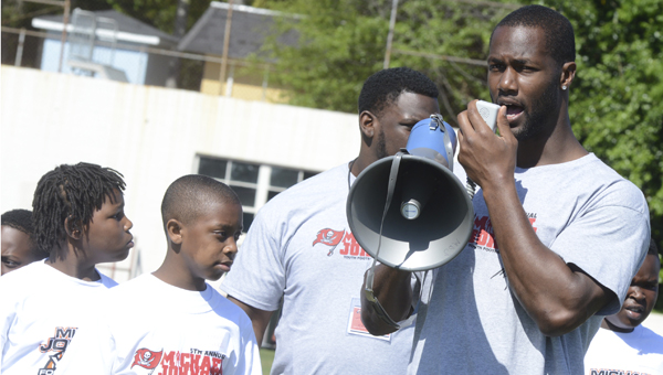 Now hear this: Selma native and Tampa Bay Buccaneer defensive lineman Michael Johnson talks to campers Saturday who were attending his annual camp in Selma. (Jay Sowers | Times Journal)