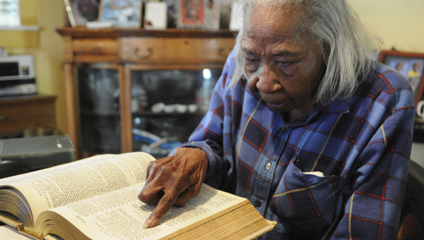 Selma resident Adell Coleman, 94, points out her favorite scripture Psalms 23 Wednesday at her home on Martin Luther King Street. Coleman has served as a church member of Concord Safford Church since she was 11-years-old with history as a traveling Sunday school teacher and choir director. (Sarah Robinson | Times-Journal)