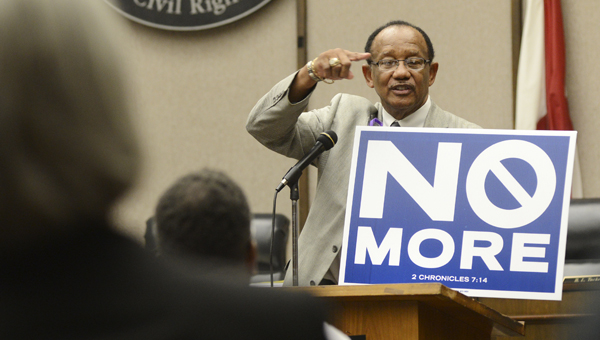 Selma Mayor George Evans talks about the No More campaign during Friday's National Murder Awareness Day rally at Selma City Hall.--Jay Sowers