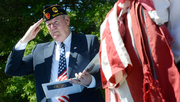 American Legion Post 20 Cmdr. Bob McMasters salutes during a ceremony Saturday morning at the Legion Post. (Jay Sowers | Times-Journal)