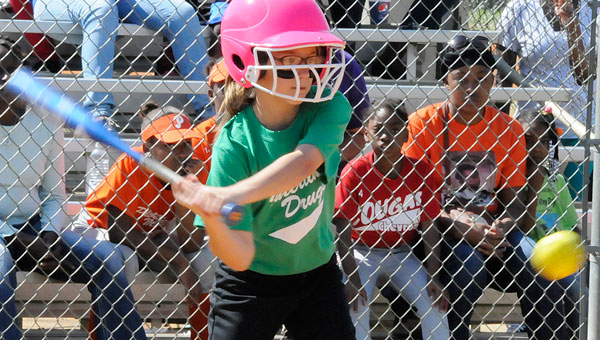 Anna Grace Small bats for Interlink Drugs in a 9 and 10-year-old softball game Saturday against Woodmen of the World at the Dallas County Sportsplex. (Daniel Evans   Times-Journal)