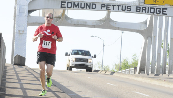 Jon Graham, from Birmingham, leads the field over the Edmund Pettus Bridge during Saturday's Butterflies and Bridges run. Graham finished first in Saturday's 8K with a time of 34:27 and won a $100 cash prize.  The run raised around $4,000 for the Selma City Schools Athletics Department.--Daniel Evans