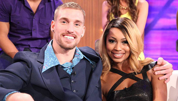 """All smiles: Dillan Ostrom, left, and Coleysia Chestnut, right, smile during MTV's """"Are You the One"""" reunion show. (Photo courtesy of MTV)"""