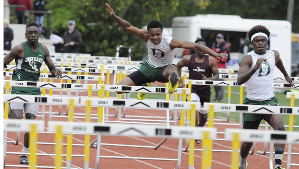 Dallas County's Quintavis Parker, above, runs in the 110-meter hurdles Tuesday during the Bobby Dolbare Invitational, finishing second with a time of 16.36 seconds to teammate Xavier Knight. Parker won the 300-meter hurdles, flipping the script and edging Knight.--Daniel Evans