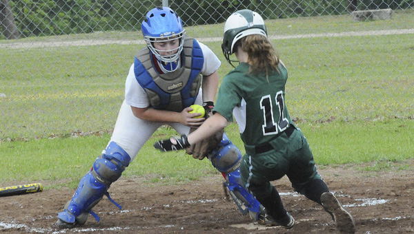 Dallas County's Brittney Brown, above, slides into home plate in the third inning of the Hornets' 14-0 victory over Verbena Tuesday night at Martin Middle School.  .--Daniel Evans