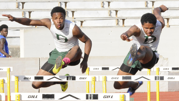 Dallas County's Quintavis Parker, left, and Xavier Mundell, right, run in the 100-meter hurdles at Thursday's Selma High School Invitational at Memorial Stadium. Parker won the event with a total time of 15.2 seconds and he also finished second in the 300-meter hurdles.--Daniel Evans