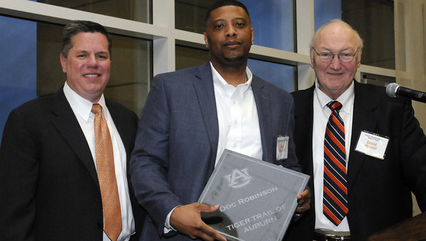 Chuck Gallina, Doc Robinson and David Housel pose for a picture at Friday night's Tiger Trail Induction Ceremony. Robinson, who played for Selma High School and helped lead the Saints to the 1994 Class 6A state championship, was inducted into the Trail Trail Friday night with six other former Auburn athletes.--Daniel Evans