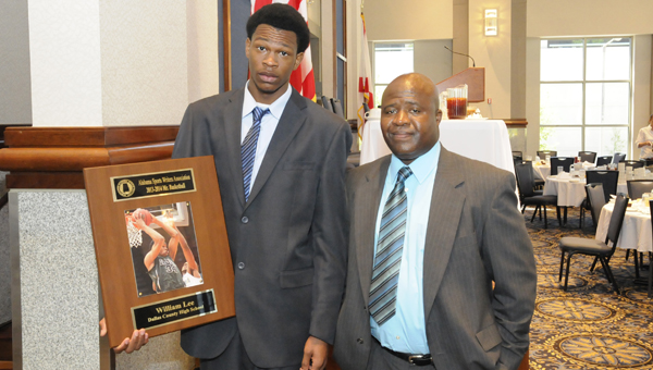 Dallas County's William Lee, left, poses with head coach Willie Moore, after winning the Mr. Basketball award Wednesday at the Alabama Activity Center in Montgomery. --Daniel Evans