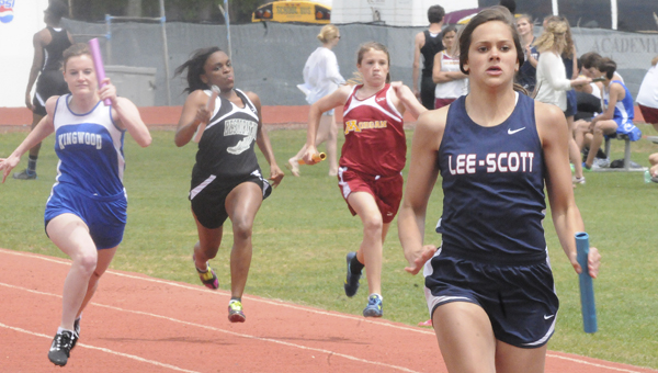 Lee-Scott's Allison Dennis right, takes a big lead in the girls 4x200 relay Thursday at Memorial Stadium as part of the AISA state track and field championships. Lee-Scott won both the women's and men's track championships Thursday in dominant fashion.--Daniel Evans