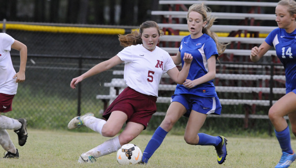 Morgan Academy's Lauren Rutherford attempts to get possession of the ball from a Macon East player in Friday night's regular season finale. The Senators lost 6-4 but will play the Knights again on Tuesday in the first round of the AISA state playoffs.--Daniel Evans