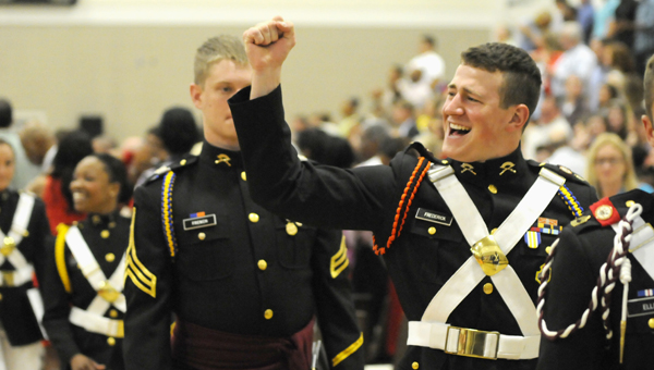 Josh Bergeron | Times-Journal We did it: Marion Military Institue graduate James Luke Frederick celebrates after receiving his degree Saturday during the school's commencement ceremony.  A total of 83 students graduated from Marion on Saturday and 64 students graduated from Concordia.
