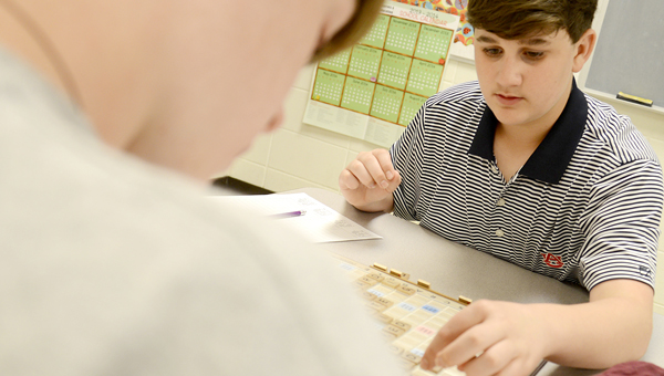 Martin Middle School students Jackson Jones, right, and Mason Tatum play a game of Scrabble Tuesday morning at the school. (By Jay Sowers |Times-Journal)