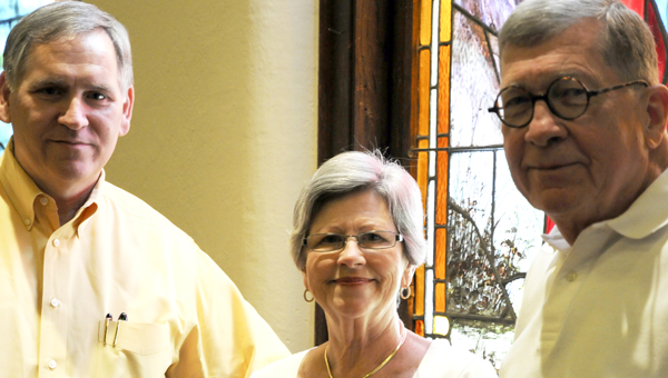 Pastor Dr. Jerry Light, left, and church members Ann Speir, middle, and Gary Thomason of First Baptist Church pose for the camera Saturday at First Baptist Church on Lauderdale Street. The church will be celebrating their 172nd anniversary Sunday at 10:45 a.m. with a special service.