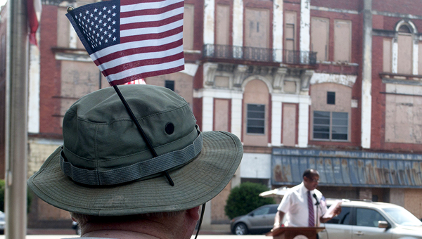 Billy Alsobrook, 73, looks on as Selma Mayor George Evans delivers a speech during a Memorial Day program at City Hall Monday. -- Christopher Edmunds