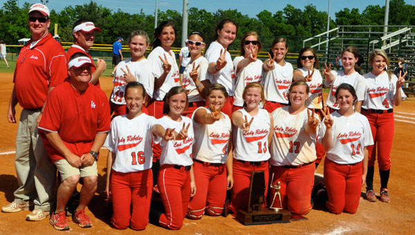 The players and coaches of the Lowndes Academy Lady Rebels pose for a team photograph, with their state title trophy, after winning the AISA Class AA State Softball Championship Saturday in Montgomery. (Fred Guarino |The Lowndes Signal)