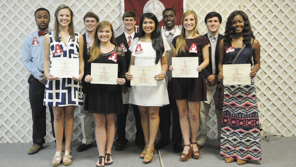 Eleven students were awarded $2,000 scholarships from the Dallas-Wilcox Bama Club Thursday night at the Church Street United Methodist Church in Selma. The following students were awarded scholarships: (back row, left to right) Aaron A. Drake, Webster Ford Manderson, John A. Olinger, Nivory Gordon III and John Edwin Robertson; (front row, left to right) Logan S. Cole, Tayler R. Fancher, Kinjal U. Patel, Mary T. Peake and Karissa A. Smiley.--Daniel Evans