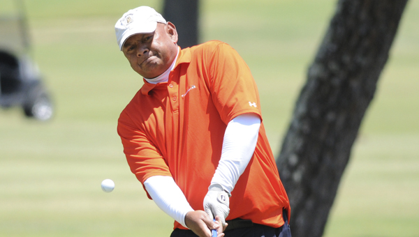 Selma's Moses Ngirailab hits a pitch shot onto the 18th green during the second round of the Alabama Golf Association's State Senior Championship. Ngirailab shot a 70, the second lowest round of the day. Only Birmingham's John Lyon shot a lower round Saturday, carding a 69.--Daniel Evans