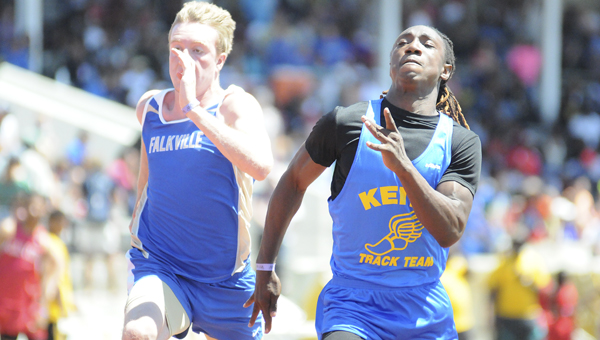 Keith's Jeremiah Campbell races a competitor from Falkville down the stretch in the boys' 200-meter dash Friday at Selma's Memorial Stadium.  Campbell finished fourth in the race.--Daniel Evans