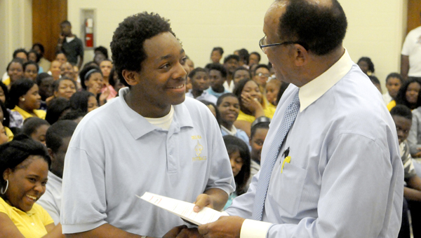 Selma Mayor George Evans, right, presents the paperwork to a student last May who was selected for one of the city summer jobs that is part of the annual Summer Youth Empoyment program in Selma.  The lottery for this summer's employment will be held Wednesday evening at the Carl C. Morgan Convention Center. -- File Photo