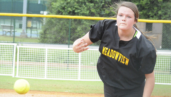 Meadowview Christian pitcher Claudia Kendrick throws a pitch in the Trojans' opening game Friday versus Edgewood Academy. The Trojans lost two of their three games and were eliminated from championship play.--Daniel Evans